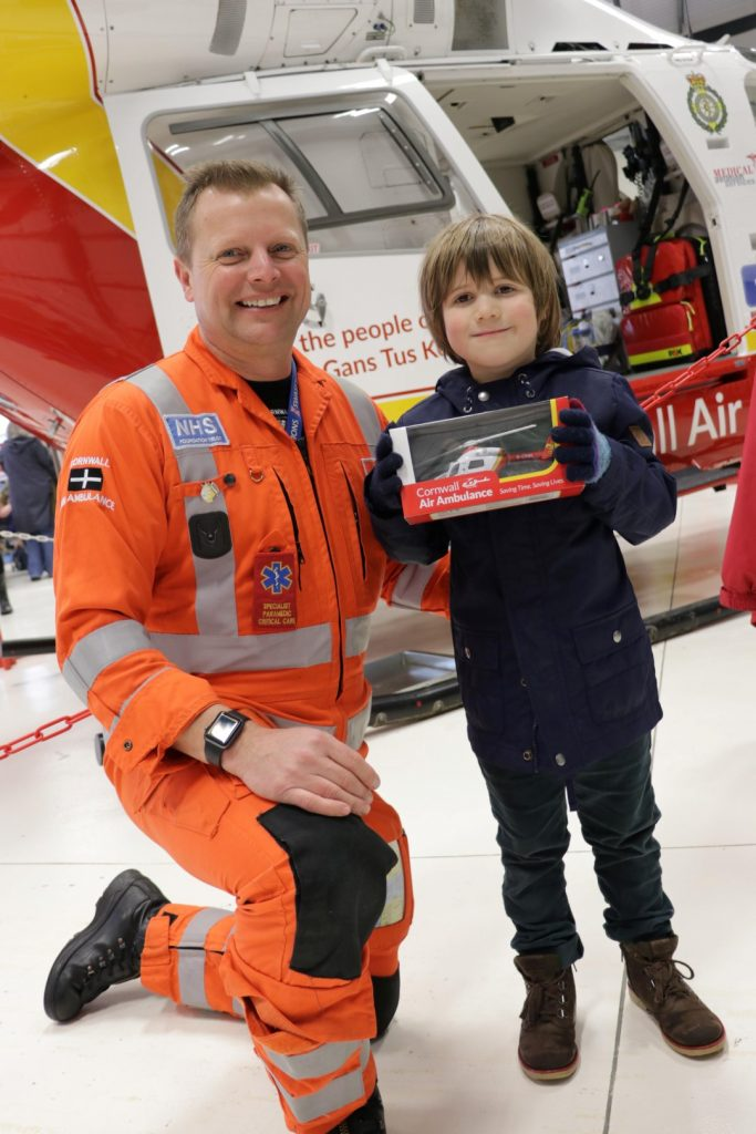 Henry Simeons, 5, with paramedic Stuart Croft edit (Large)